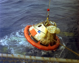Apollo 8 Command Module being recovered after splashdown.
